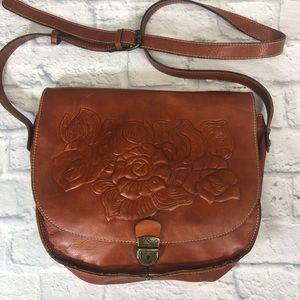 Patricia Nash Leather floral saddle crossbody bag